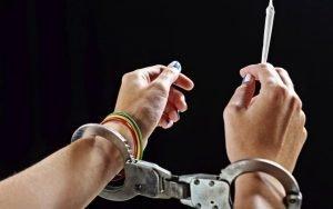 Image of handcuffs and marijuana